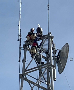 Eagle effigy being mounted on cell tower